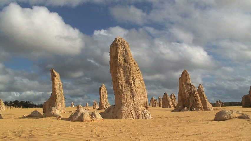 Time lapse of the Pinnacles showing limestone pillars which tower out of the flat, sandy desert, some a few cms, some up to five metres high, Nambung National Park Western Australia