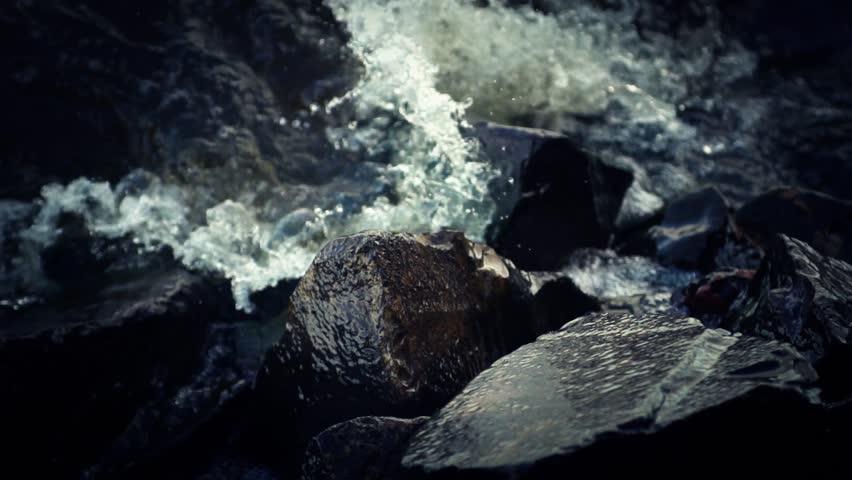 Water splashing against rocks (super slow motion) - HD stock video clip