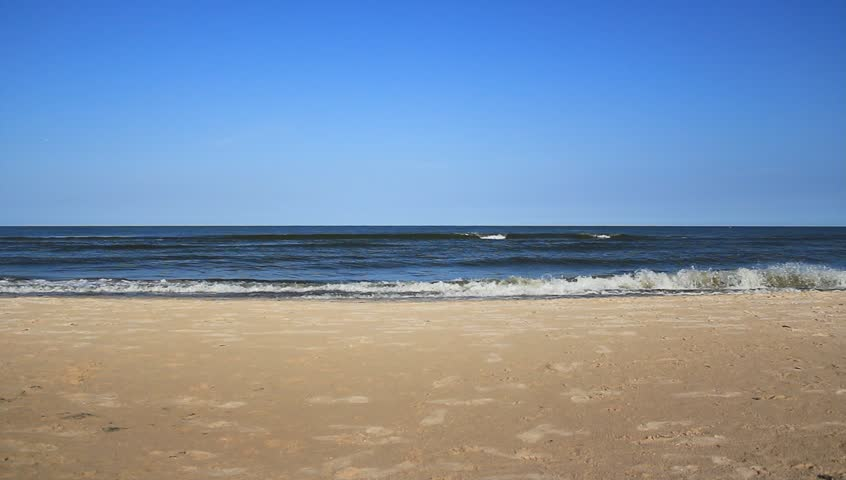 Static scene. Blue sky and sand. Sea water, waves. Perfect scene for background use. - HD stock video clip