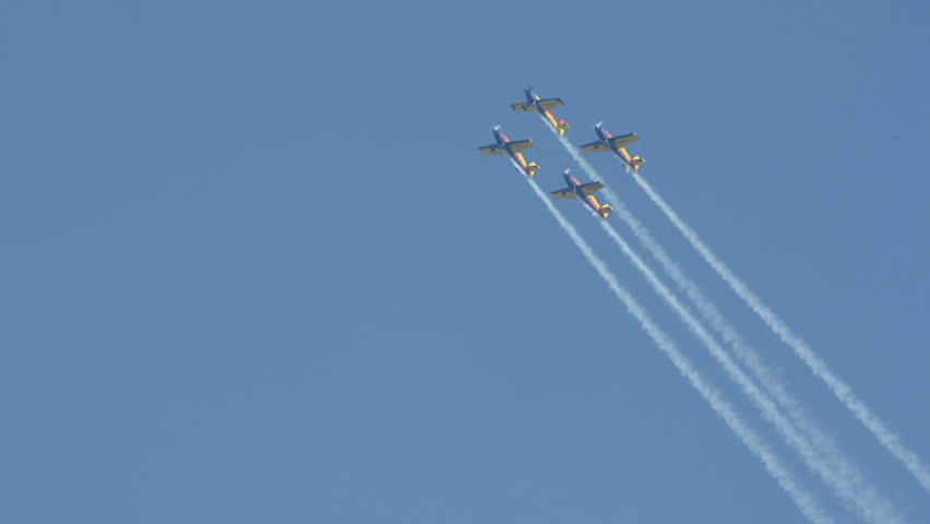 "CLUJ NAPOCA, ROMANIA - CIRCA OCTOBER 2013 -  Aerobatic planes do barrel roll in formation flying  ""Aeroclubul Roman""    at Cluj Napoca Airport grand reopening airshow."