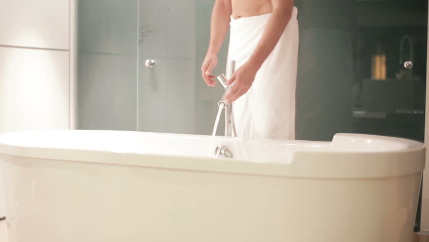 Young man taking bath in bathtub stock footage video for Bathroom hot images