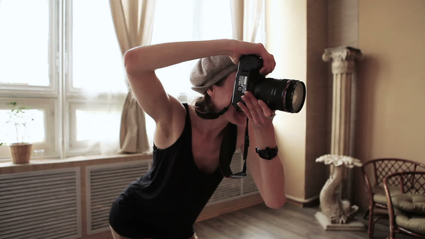 Young beautiful photographer with the professional camera  - HD stock video clip