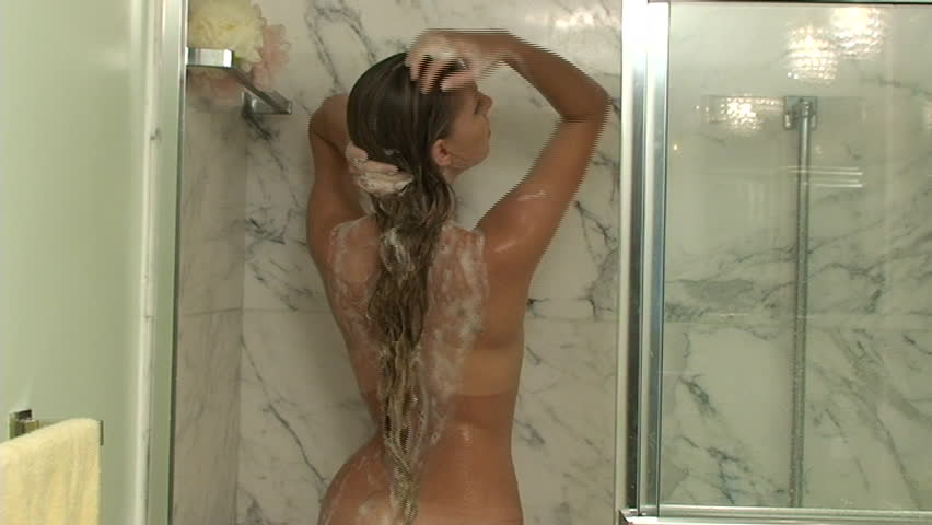 Young woman washing her hair under the shower - SD stock footage clip