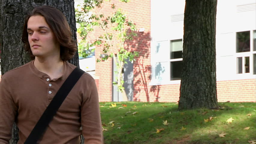 A male student confidently looks at the camera. - HD stock video clip
