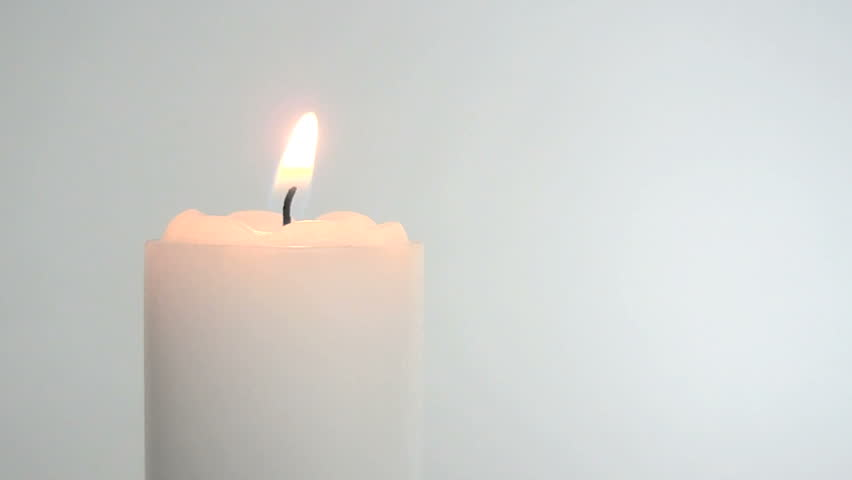 White Candle Burning At Both Ends Against A Black Background. Looping ...