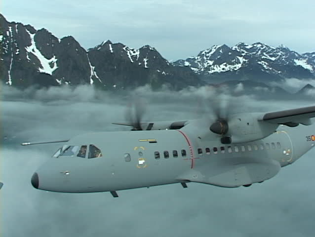 Alaska: Casa C-295 conducts test operations in Alaska 2004. Views from cockpit, tail cam, and fly bys. This is a very high performance aircraft. - SD stock video clip