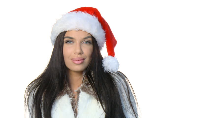 Sexy girl wearing santa claus hat sending kiss