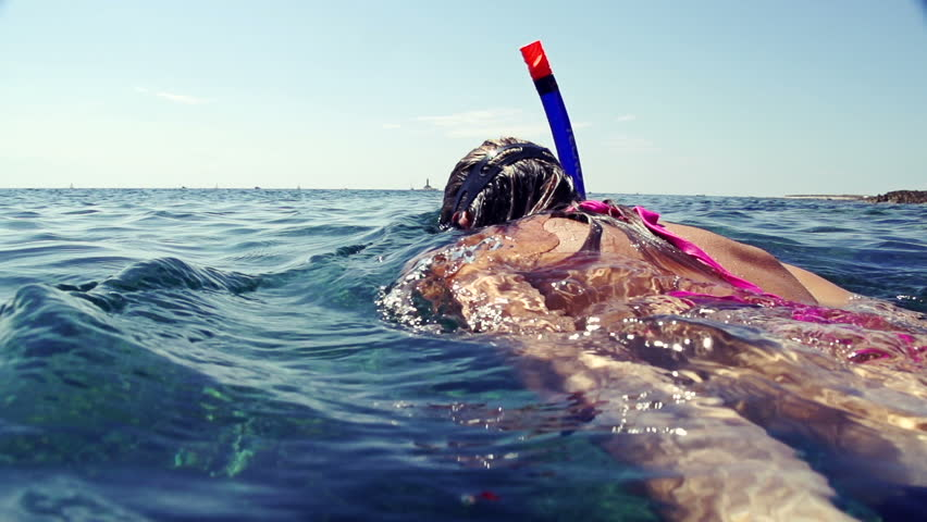 SLOW MOTION: Snorkeling on water surface