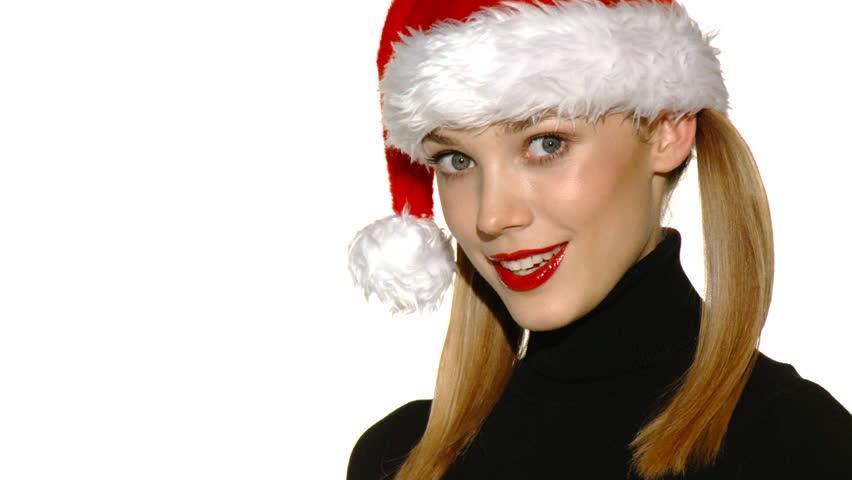 Portrait of beautiful sexy girl wearing santa claus hat