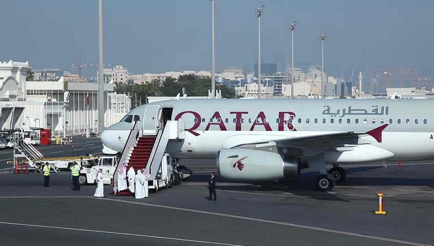 DOHA, QATAR - JANUARY 20: Sheikhs embark airplane of Qatar Airways at Doha airport, Qatar, January 20, 2014.