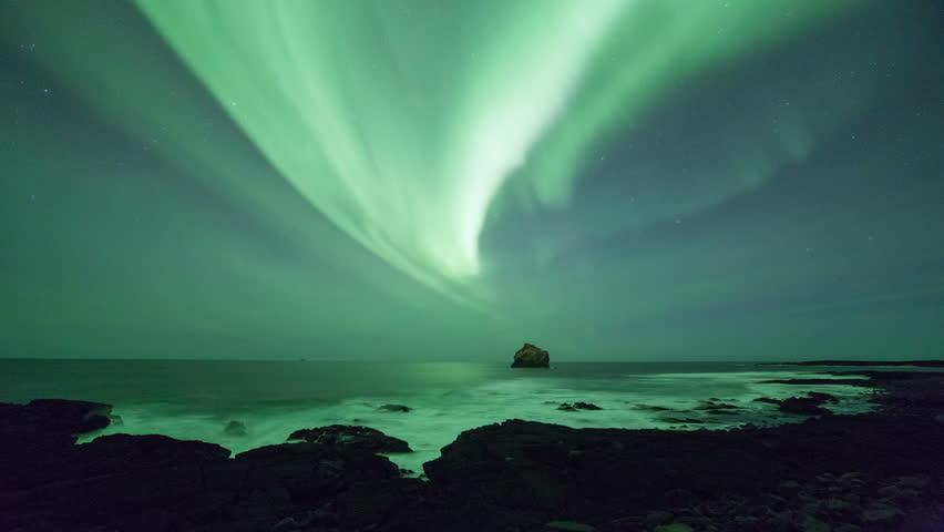 Aurora borealis seen off the rugged coast of Reykjanes, Iceland