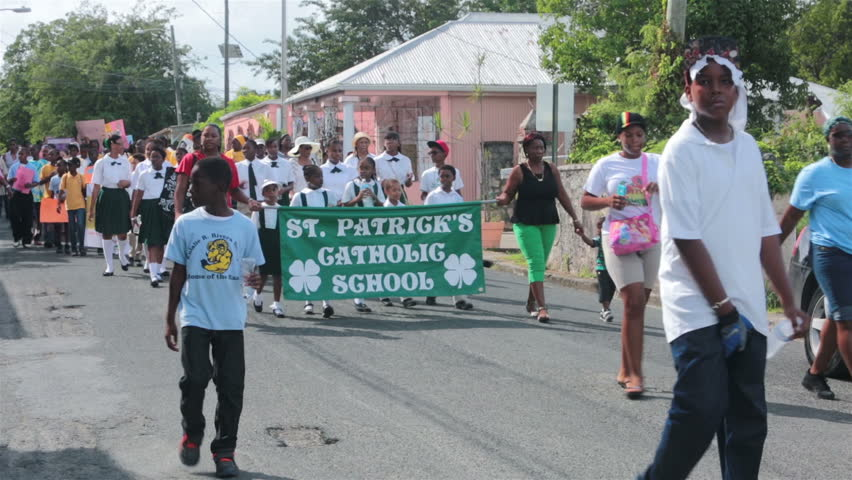 ST CROIX - JAN 2014: St Croix Island MLK Parade march. Martin Luther King freedom parade through Frederiksted. American Virgin Islands. Hundreds of school children, labor organization for solidarity.