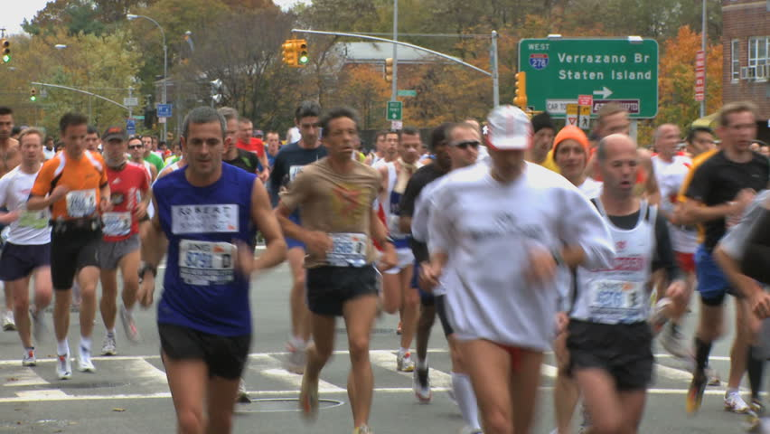 NEW YORK CITY - NOVEMBER 1: With the Verrazano Bridge behind them, runners look to conquer the rest of the course in the 2009 New York Marathon. - HD stock video clip