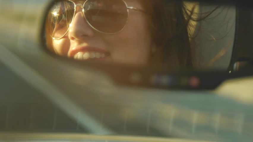 Attractive Teen Driver Looks In Rearview Mirror