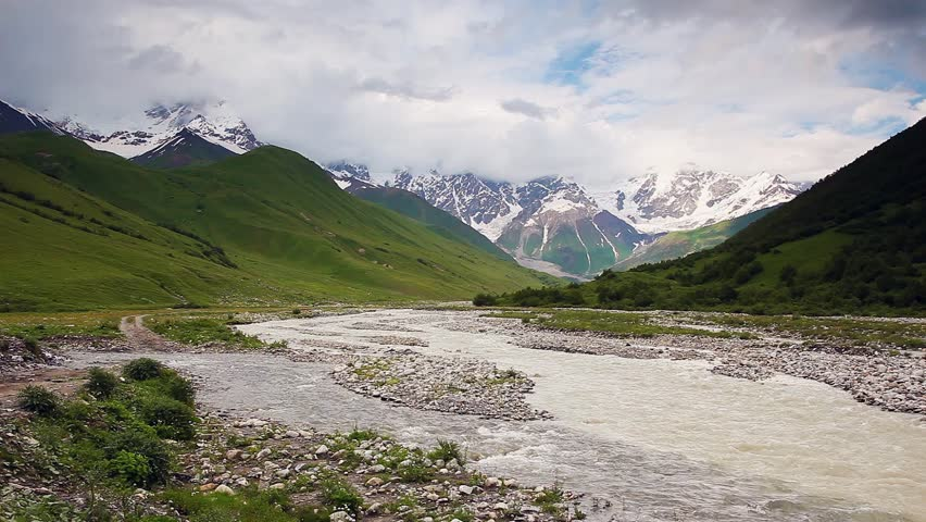 River in mountain valley at the foot of  Mt. Shkhara. Upper Svaneti, Georgia, Europe. Caucasus mountains. Beauty world. HD video clip (High Definition)