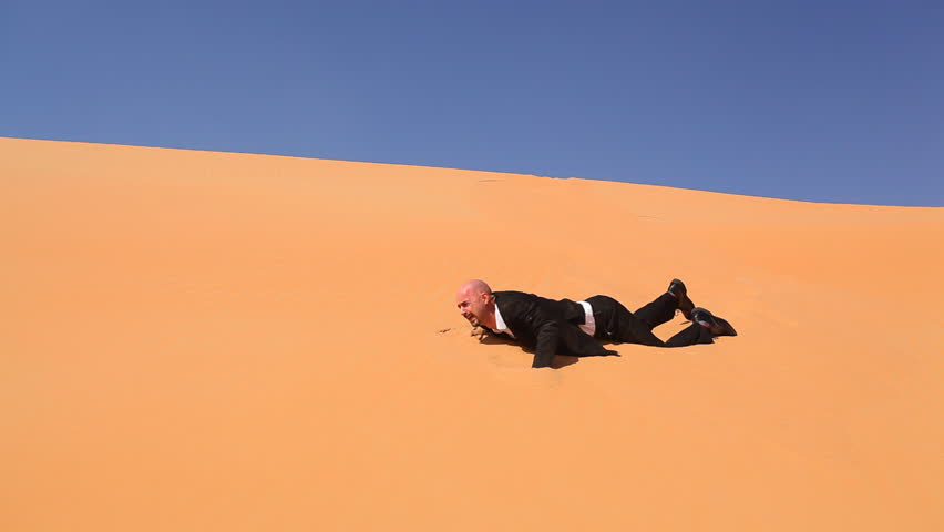 hopeless businessman crying in desert part I - HD stock video clip