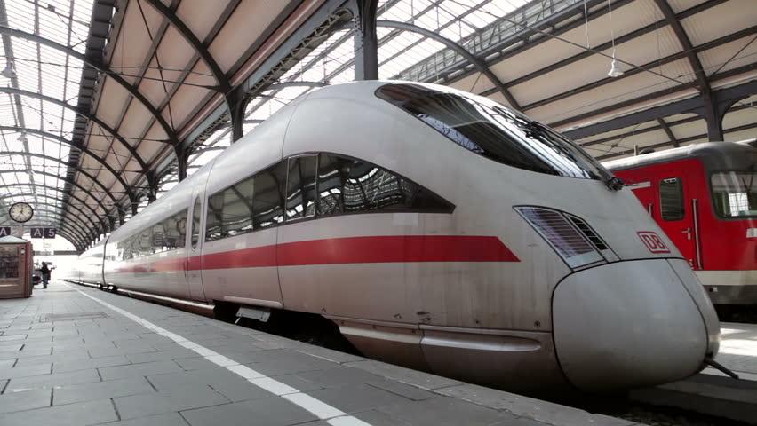Wiesbaden, Germany - March 13, 2014: A German highspeed ICE train is leaving main station Wiesbaden, some passengers walking on the platform