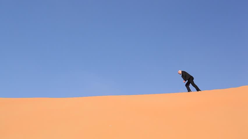 hopeless and weak businessman alone in desert - HD stock footage clip