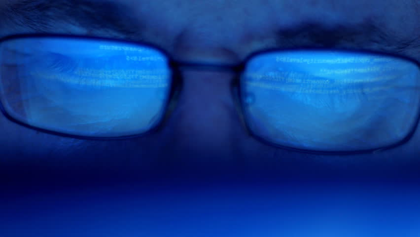 Tracking shot  of computer screen and code reflected in man's glasses - HD stock footage clip