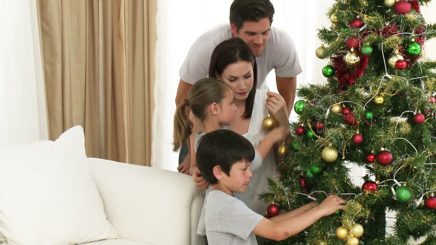 Footage In High Definition Of Family Decorating A