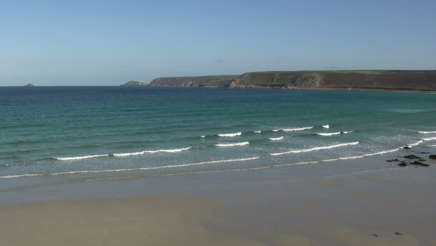 Gentle waves reaching Sennen cove beach, Cornwall UK. - HD stock video clip