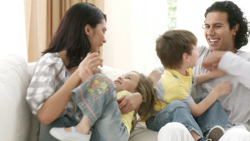 Footage in high definition of happy family playing on the sofa - HD stock footage clip