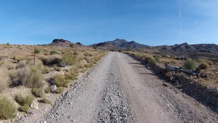 Off-road driving and passing free-range cattle on high-desert mountain trails.  POV filmed in the mountains between St. George, UT and Mesquite, NV.
