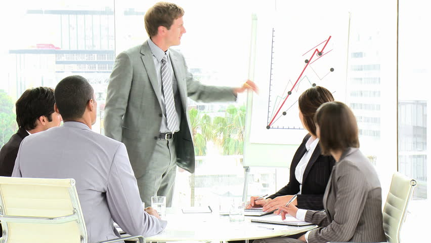 An Attractive Businessman Reporting Sales at Business Meeting: HD - HD stock footage clip