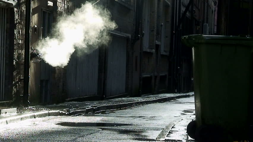 Steam coming from outlet in dirty, dark back alley #602191
