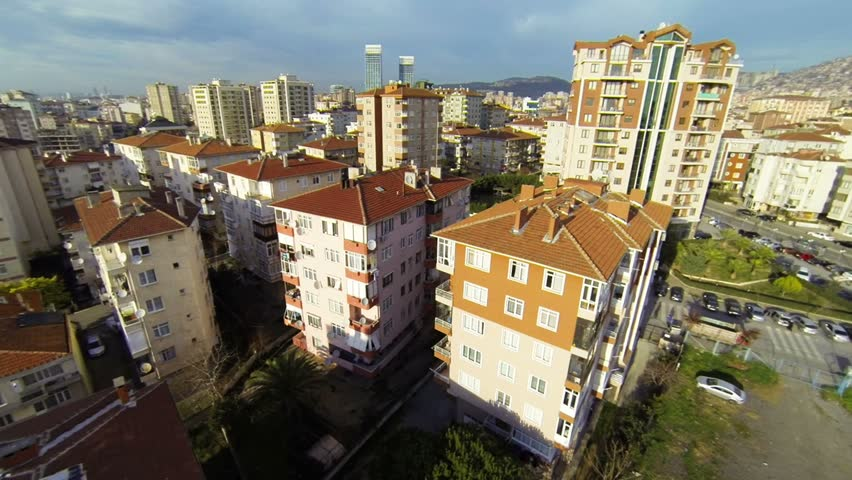 Cityscape with roofs of many houses and buildings at morning. Aerial video footage of a residential housing community in Istanbul.