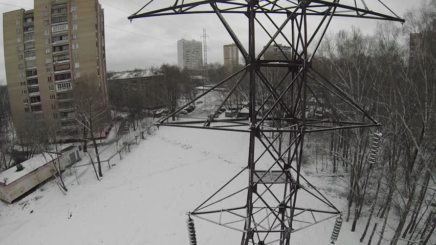Electricity line pillar without wires at city outskirts in winter day. Aerial view - HD stock footage clip