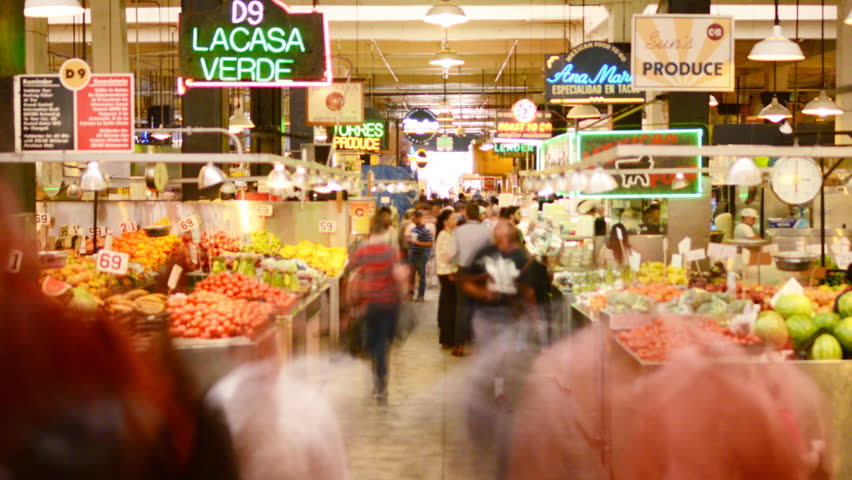 LOS ANGELES, California - April 9th: Time lapse Photography of unrecognizable shoppers gather at historic Grand Central Market in Downtown Los Angeles on April 9th.