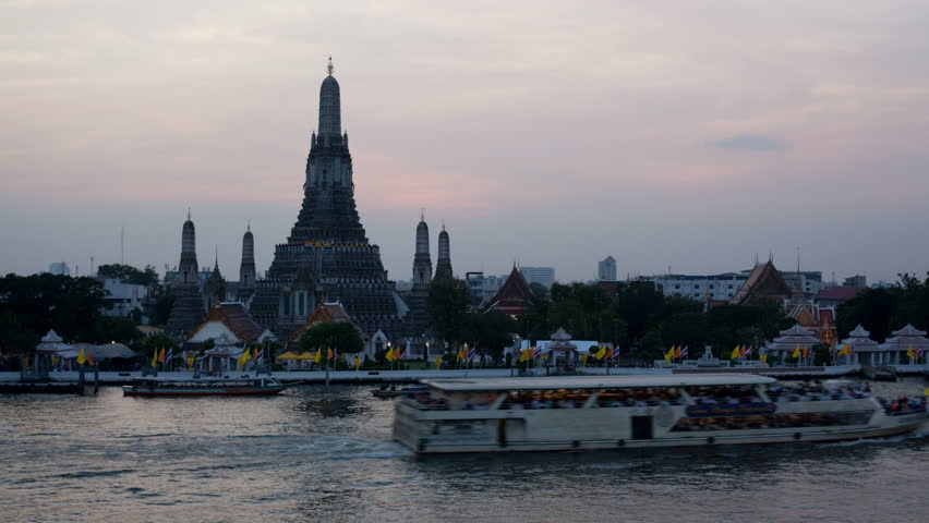 Timelapse of sunset and dusk at Wat Arun in Bangkok, Thailand - HD stock footage clip