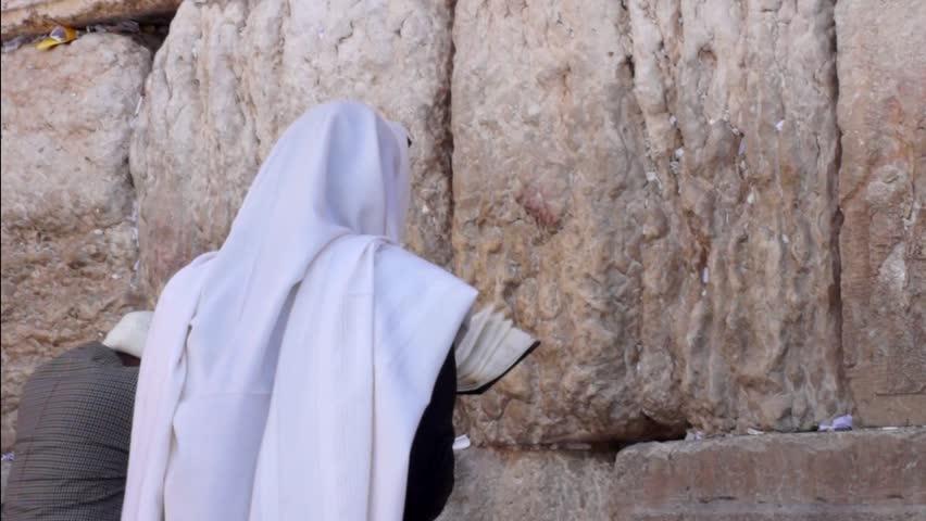 Jewish man prays at the western wall
