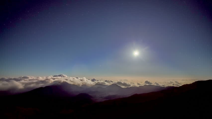 Rising Sun, Moon, Stars, over high mountain range summit  - 4K stock footage clip
