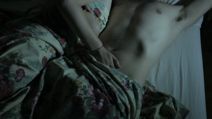 young lovers in the bed - kiss and passion - sex - kiss