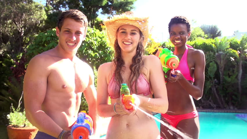 Friends playing with water guns