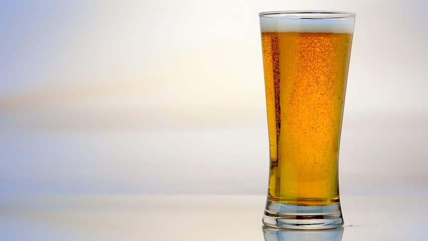Beer Glass Pour on White Background - HD stock video clip