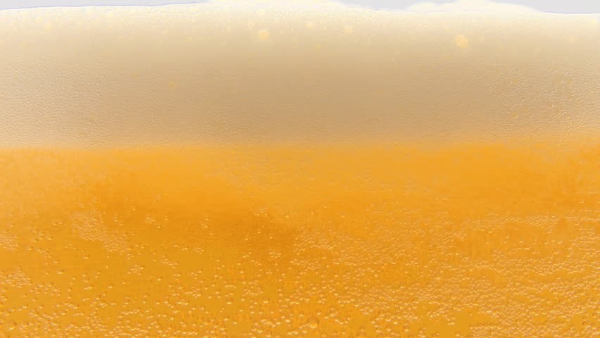 Pouring cold beer into glass - HD stock footage clip
