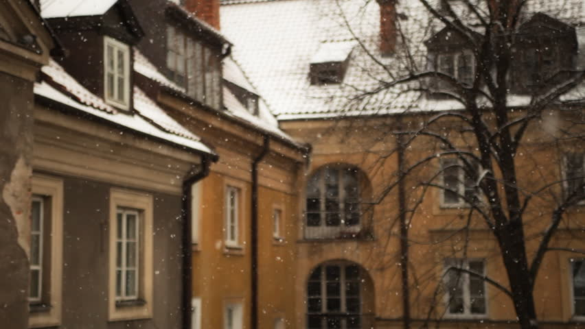 snowing in the courtyard of old town in Warsaw - HD stock video clip