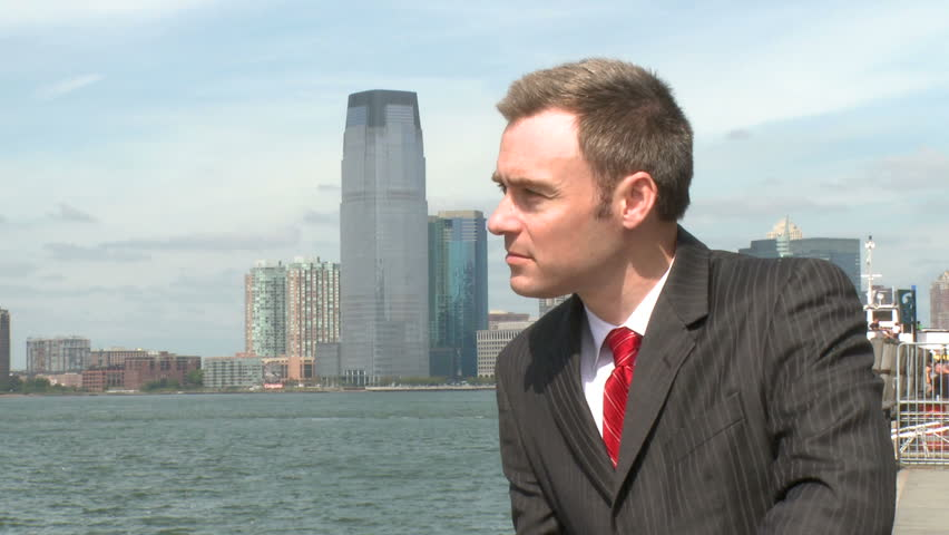 Stressed male professional by the waterfront (2 of 2) - HD stock footage clip