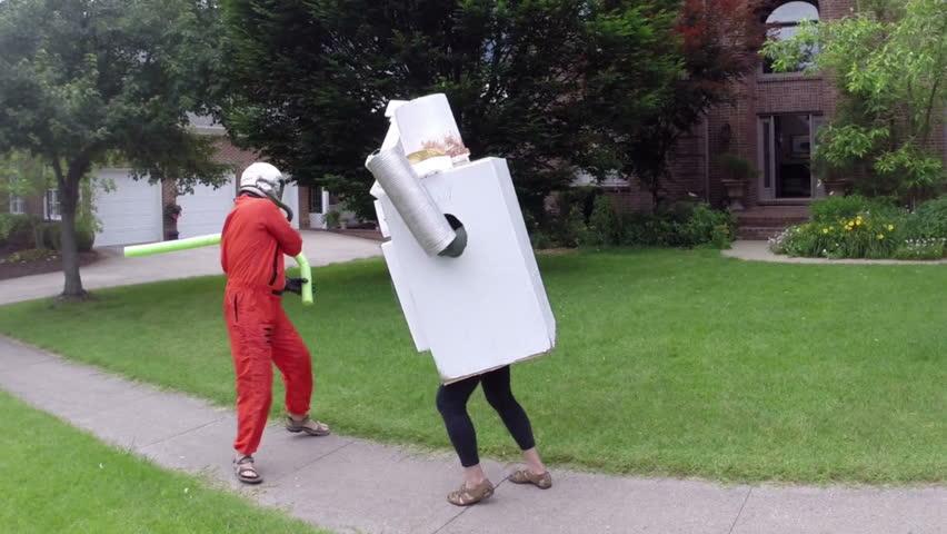 Astronaut fighting a robot. nonsense concept. - HD stock video clip