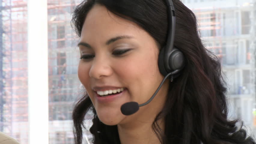 Laughing customer service representative at work - HD stock video clip