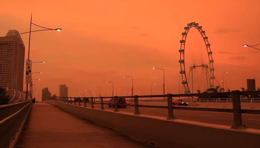Singapore_21 May, 2014: Singapore Flyer and city traffic at Marina Bay in Singapore at beautiful sunset - HD stock video clip