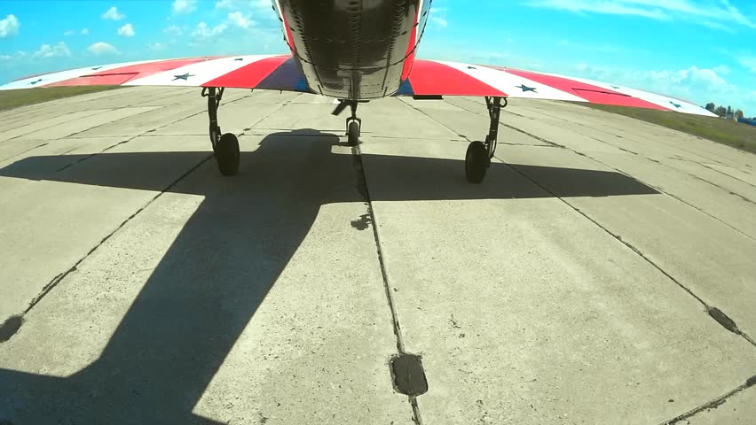 Small plane takes off from the concrete runway - HD stock video clip