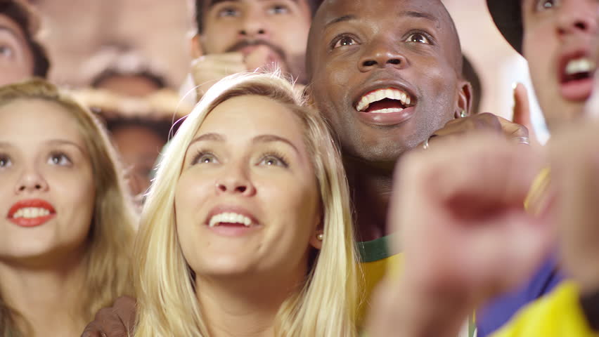 Brazilian Fans Watch a Soccer Game at a Sports Bar