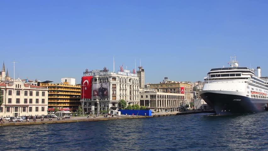 ISTANBUL - OCT 6, 2011: Cruise Ship Terminals from the water side. The docks for cruise ships extend along the shore from Karakoy Port to the Tophane Region. Pan from Kabatas to Karaköy.