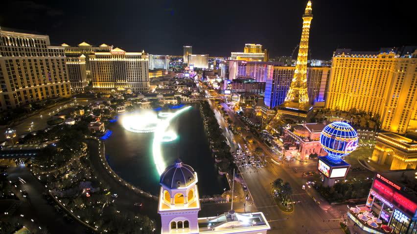 Las Vegas - January 2014: Time lapse illuminated Bellagio Hotel fountain Eiffel Tower Caesars Palace Las Vegas Blvd, Nevada, USA | Shutterstock HD Video #6714217