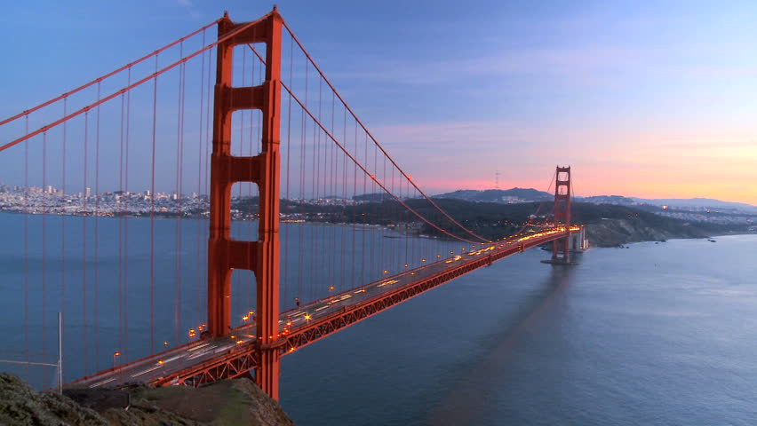 Time-lapse of traffic on Golden Gate Bridge, San Francisco at sunset - HD stock footage clip