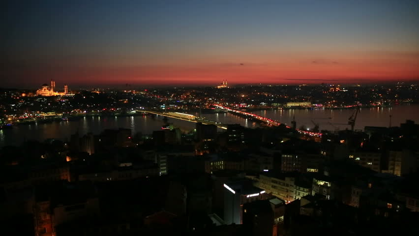 Night view of Istanbul and bosphorus with mosques lights ships at Sunset
